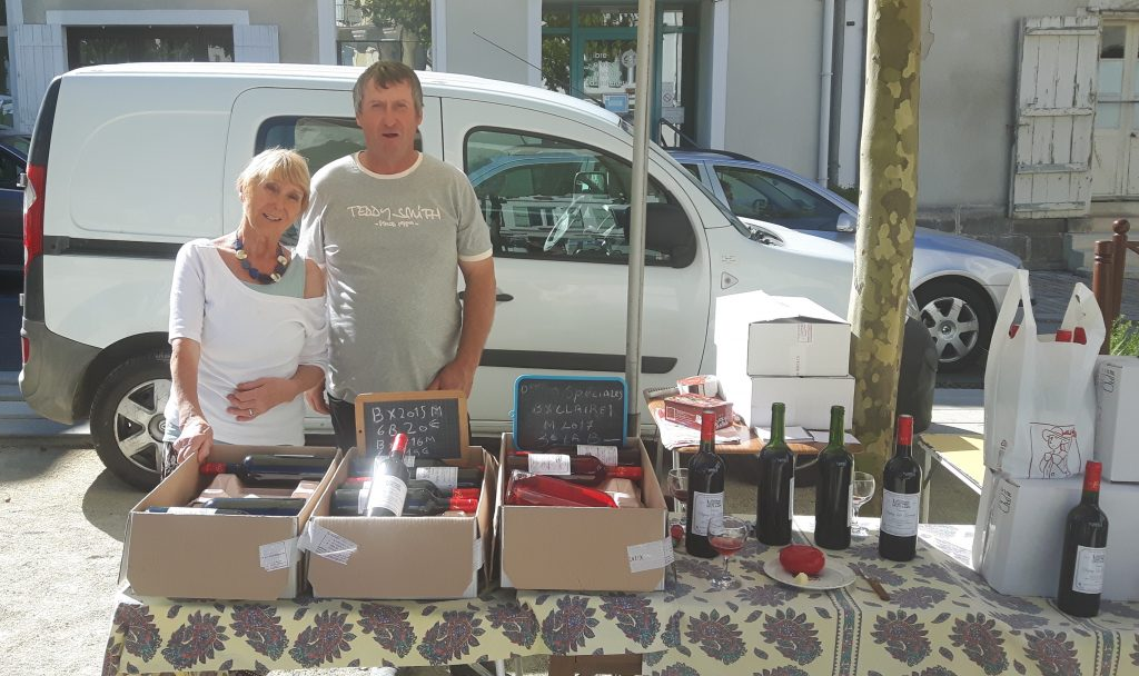 Wine for sale in market in the Dordogne.