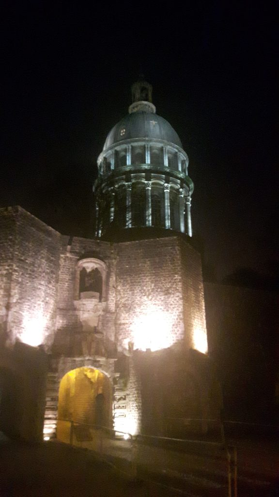 Boulogne cathedral and old town entrance, at night